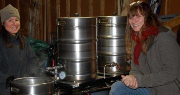 Split Rail founders Andy Smith and Eleanor Charlton are budding brewers as they pose with their prototyping brewing equipment. The real deal will be many, many times larger than this system.