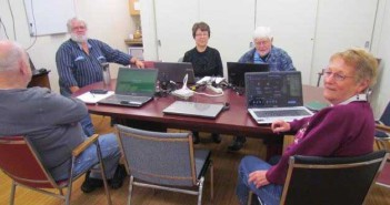Pictured are participants in the free computer classes for seniors offered at the Mindemoya library including instructor Wes Cline, Carol and Bruce Lee, Joan Ralph and, with his back to the camera, Wayne Sanders.