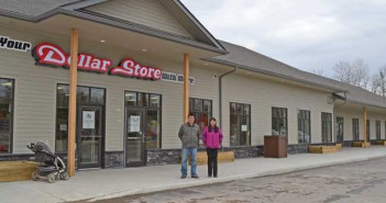 Wikwemikong Chief Duke Peltier and Wikwemikong Development Commission general manager/EDO Mary Lynn Odjig stand in front of the band's new store 'Your Dollar Store With More.' The store, along with the new mall it occupies space in, is part of the band's ongoing efforts to develop the community's economy.