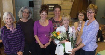 Members of the Manitoulin Centennial Manor Auxiliary gather to present a bouquet of flowers and to serenade retiring activity coordinator Nina Coates during a recent volunteer appreciation luncheon.