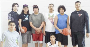 Wikwemikong b-ballers Adrian Trudeau, Colten Trudeau, Wyatt Metansinine-Bell, Jenmee Bondy, Gregory Trudeau-Paquet, Dante Kitchikeg, back row, Bradlee Kitchikeg (kneeling) and John Matheson (sitting) pose for a photo at the Team Ontario tryouts. Missing from photo is Shanna and Taylor Peltier.