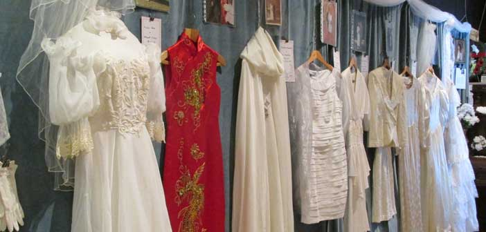 Old Mill Heritage Museum displays historical wedding gowns and cakes