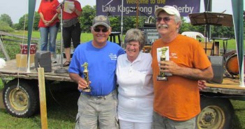 Maurice Popelier and John Cada accept first prize from Joan Brough at the  Kagawong small mouth bass tournament held August 9.