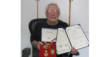 Gore Bay resident John Gridley, a veteran of the Korean War, displays his Ambassador for Peace medal and proclamation presented by the Embassy of the Republic of Korea.