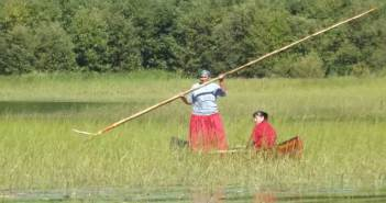 The long pole is used to propel the canoe through the wild rice beds and works well to keep balance in place too.