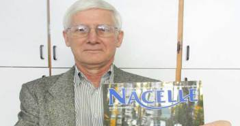 Brad Middleton of Evansville holds up a copy of the November 2014 issue of 'Nacelle,' a British motorcycle magazine which features the first of a two part article he has penned for the magazine.