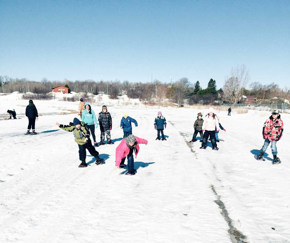 Enjoying the spring sunshine with snowshoe races at the Manitowaning arena.