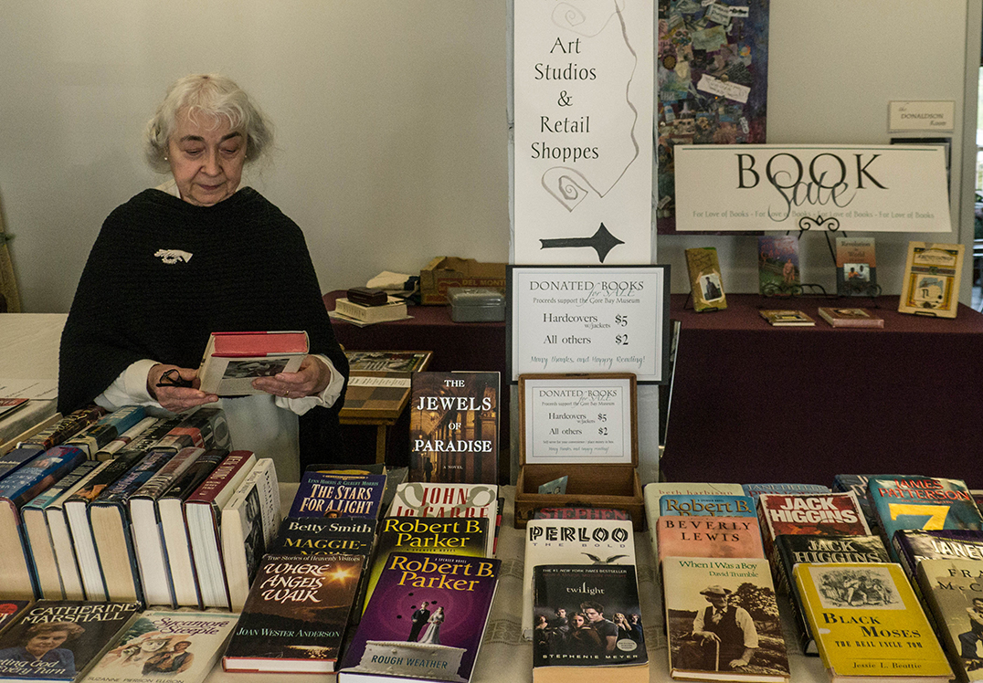 Critical to the vision and development of the Harbour Centre has been Nicole  Weppler, director of the Gore Bay Museum, seen here at the fundraising book sale in the lobby of the waterfront building.