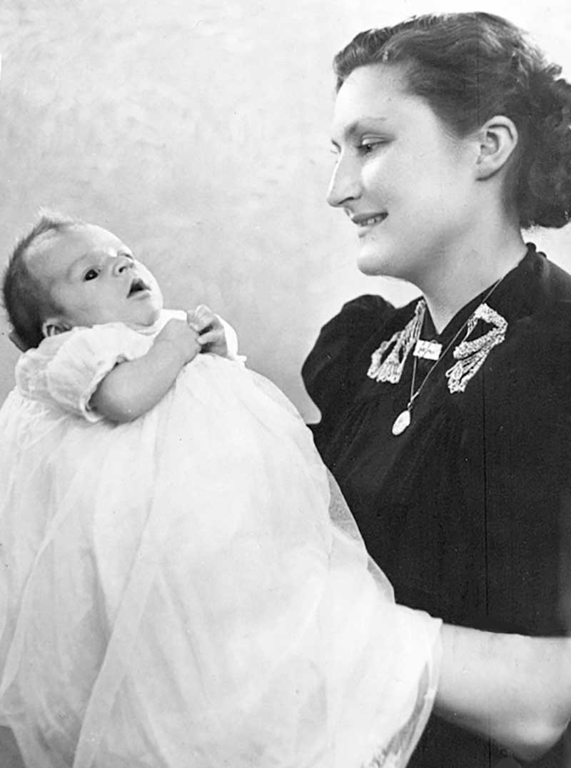 John Hodder christened at three months in 1942 under the loving gaze of his mother.