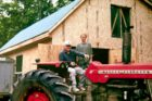 NT-Ted-and-his-granddaughter-Diana-on-one-of-many-tractors-he-has-repaired–c.-1912