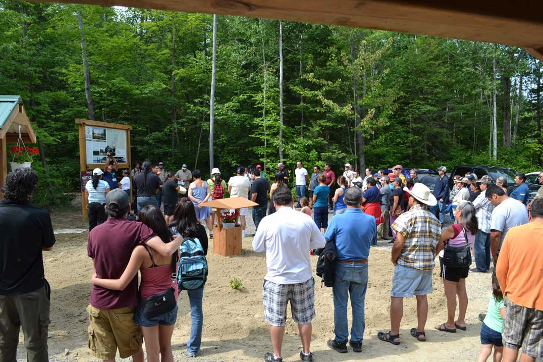 A large group gathers for the official opening of Pointe Grondine Park at the trailhead.