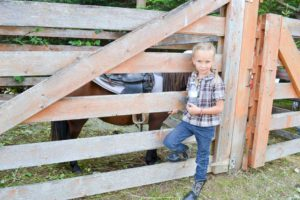 Silva Verboom, age 6, and her miniature horse.