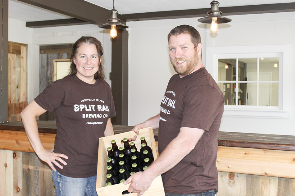 Andrea Smith sells the first case of Split Rail brew to Richard of Buoys Restaurant.