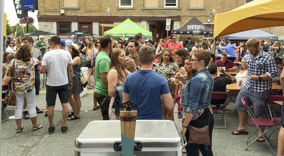 The crowd before the Manitoulin Brewing Co. tent was full at the Elgin Street Craft Beer Festival.