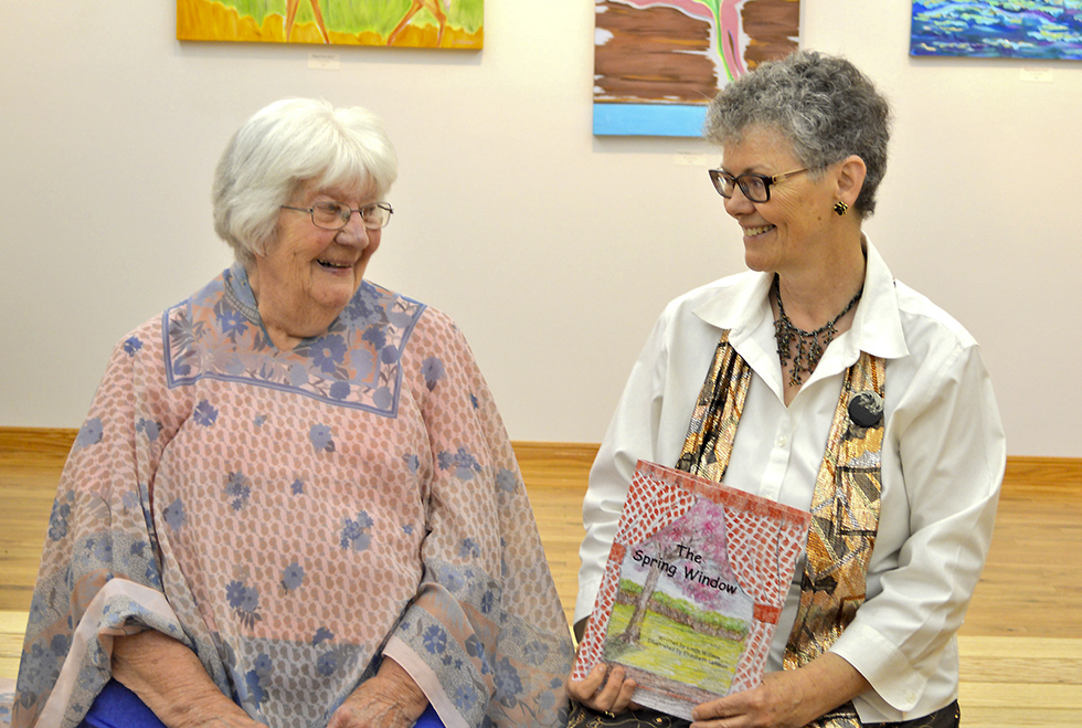 Author Linda Willson, right, and illustrator Elizabeth Lehman at the launch of Willson's second book of poems of the four seasons, 'The Spring Window,' at the Gore Bay Museum in June. photo by Jan McQuay