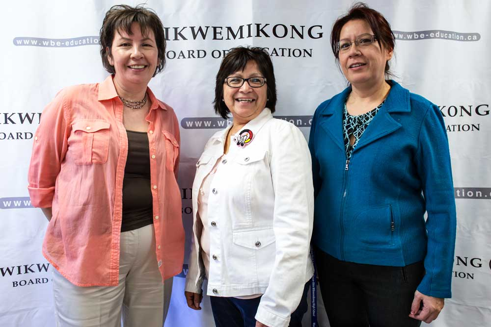 Cathy Fox, Tish Manitowabi and Patty Debassige pose on the 'red carpet' during the official launch of the new Wikwemikong Board of Education website.
