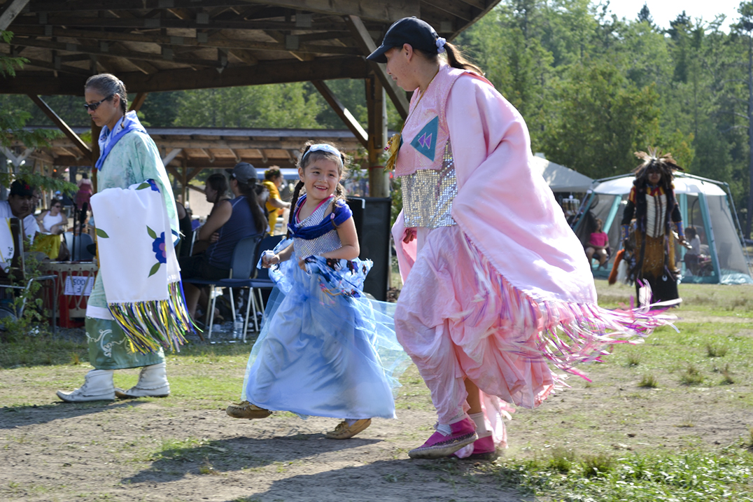 BELOW: Two shawl dancers share a smile during a intertribal dance.